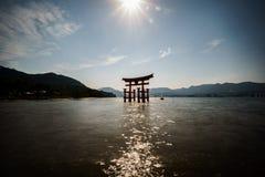 Miyajima island and Floating Torii gate in Japan. backlit Stock Photo