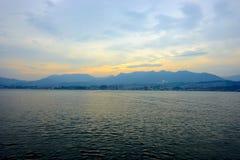 Sunset over the mountains afterglow sky clouds. Miyajima Island, Hiroshima, Japan, October 2017: Sunset over the mountains afterglow sky clouds royalty free stock photo