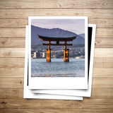 Miyajima Japan memory on photo frame brown wood plank background Royalty Free Stock Photos
