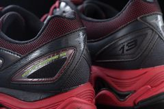 Mizuno wave inspire 13. SONGKHLA, THAILAND - FEBUARY 16, 2018: Mizuno Wave Inspire 13 running shoes on black background. Mizuno was founded in 1906 as Mizuno stock photo
