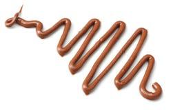 mjölka chokladsås som isoleras på en vit bakgrund Fotografering för Bildbyråer