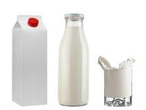 Mjölka flaskan, & tetrapak och frysningen mjölkar i exponeringsglas Arkivfoton