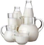 Mjölka i exponeringsglas som isoleras på vit bakgrund Royaltyfri Fotografi