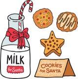 Mjölka kakor för Santa Claus Arkivbilder