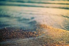 Mjuk färgsand och vattenbakgrund Arkivfoto