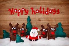 Mjuka leksaker för jul som hjortar och Santa Claus göras av filt Arkivbild