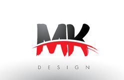 MK M K Brush Logo Letters with Red and Black Swoosh Brush Front. MK M K Brush Logo Letters Design with Red and Black Colors and Brush Letter Concept Royalty Free Stock Photo