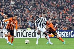 Mkhitaryan pushing Paul Pogba Stock Image
