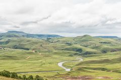 Mlambonja River near Cathedral Peak in the Kwazulu-Natal Drakens. A farm landscape with the Mlambonja River near Cathedral Peak in the Kwazulu-Natal Drakensberg Stock Photos