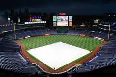 MLB Atlanta Braves - Rain Delay. A view of an empty Turner Field, home of the Major League Baseball Atlanta Braves, during a rain delay with the tarp covering Stock Image