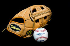 MLB baseball ball and glove. ZAGREB , CROATIA - SEPTEMBER 17 , 2014 :  MLB official ball and baseball leather glove on black background, product shot Stock Photography