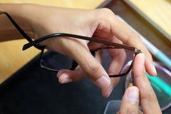 Mleje obiektyw w eyeglass obrazy royalty free