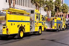 MLK Day Parade in Las Vegas. Las Vegas, Nevada - January 21, 2013: Nright yellow fire trucks from Clark County F.D. participate in the Martin Luther King Day Royalty Free Stock Photo