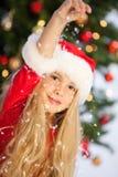Mlle Santa avec la neige Photographie stock