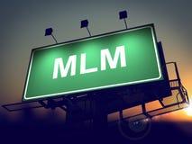 MLM - Billboard on the Sunrise Background. MLM - Multi-Level Marketing - Green Billboard on the Rising Sun Background Stock Image