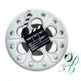 35mm戏院放映机的原始的大电影卷轴有拍板的 免版税库存图片