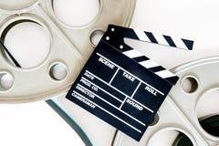35 mm电影放映机的两个电影卷轴有拍板的和 免版税库存图片