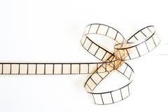 35mm电影filmstrip,在白色背景的影片弓 库存照片