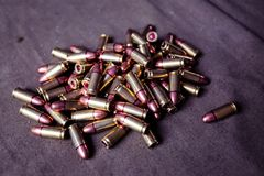 9mm ammunition with cartridges. On a military shooting range Stock Photo