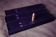 9mm ammunition with cartridges. On a military shooting range Royalty Free Stock Photo