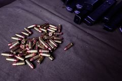 9mm ammunition with cartridges. On a military shooting range Stock Photos