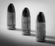 9mm in Black & White. Three 9mm black & white bullets lined up in a row Stock Photography