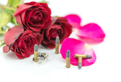 9 mm bullet and beautiful red rose on white background Royalty Free Stock Photo