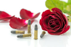9 mm bullet and beautiful red rose on white background Stock Photos