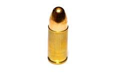 9 mm or .357 bullet on white background. 9 mm or .357 bullet isolated on white background stock photography