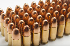 9mm bullets in a row. On white background Stock Photos