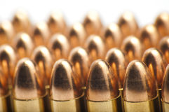 9mm bullets in a row. On white background Stock Photography
