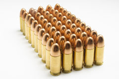 9mm bullets in a row. On white background Royalty Free Stock Photography