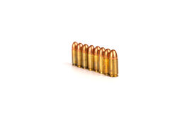 9mm.bullets 8shots. 9mm.bullets 8 shots abreast oneline on white background Stock Photo