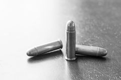 9mm bullets on table Royalty Free Stock Images