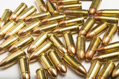9mm bullets on white background. Lots of 9mm bullets on white background Stock Images