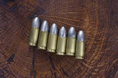 The 9mm caliber cartridges. On wooden background Stock Images