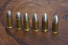 The 9mm caliber cartridges. On wooden background Royalty Free Stock Image