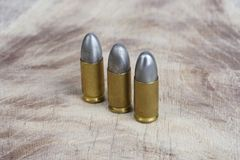 9mm caliber cartridges. On wooden background Stock Photography