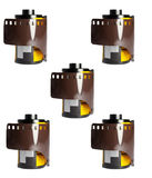35 mm camera films on white. Generic film camera 35 mm rolls on white background Royalty Free Stock Photos