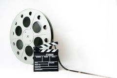 35mm cinema big reel with film and movie clapperboard Stock Photography