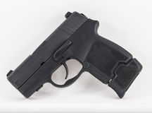 9mm Compact Pistol  on White Background Stock Photos