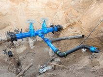 500mm drink water pipes joined with new blue Gate valves and new black waga multi joint members. Royalty Free Stock Image