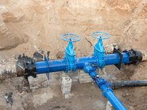 500mm drink water pipes joined with new blue Gate valves and new black waga multi joint members. Royalty Free Stock Photo