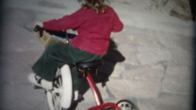 (8mm Film) Girl Riding Tricycle In Circle 1957 stock video footage