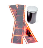 35mm film negative and roll container. On white background Stock Photos