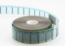 35mm film reel. On white base loose Stock Images