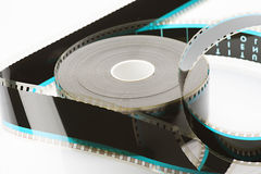 35mm film reel. On white base loose Stock Photo