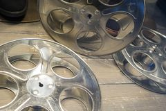 35mm film reels empty without film on wood floor. Steel Film reels for motion picture industry and movie theaters stock photo