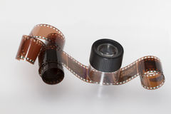 35mm film roll. With a magnifing glass Stock Image