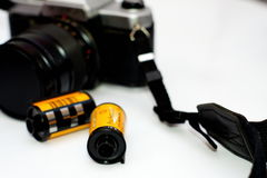 35mm Film rolls and film camera. Film rolls and film camera ,Selective focus royalty free stock image
